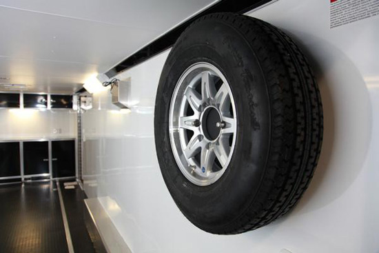 SPARE TIRE MOUNT ON INTERIOR WALL
